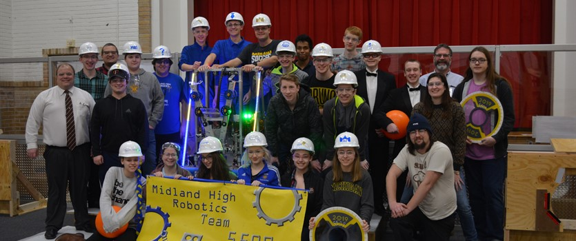 Midland High Robotics Team pose for a picture